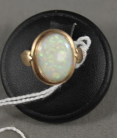 14: 9ct Gold and Opal Ring,