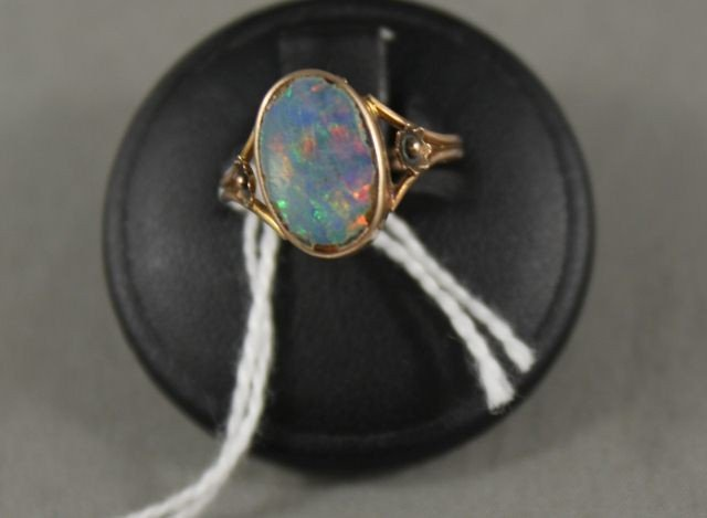 15: Saunders 9t Gold and Opal Ring,