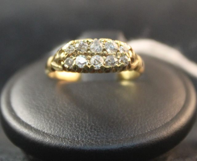144: 18ct Gold and Diamond Ring,