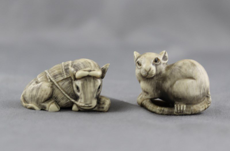 Two Ivory Okimono,