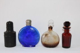 Four Perfume Bottles And Stoppers,