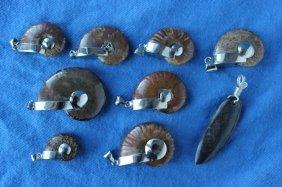 Nine Opalized Ammonite Fossil Pendants,