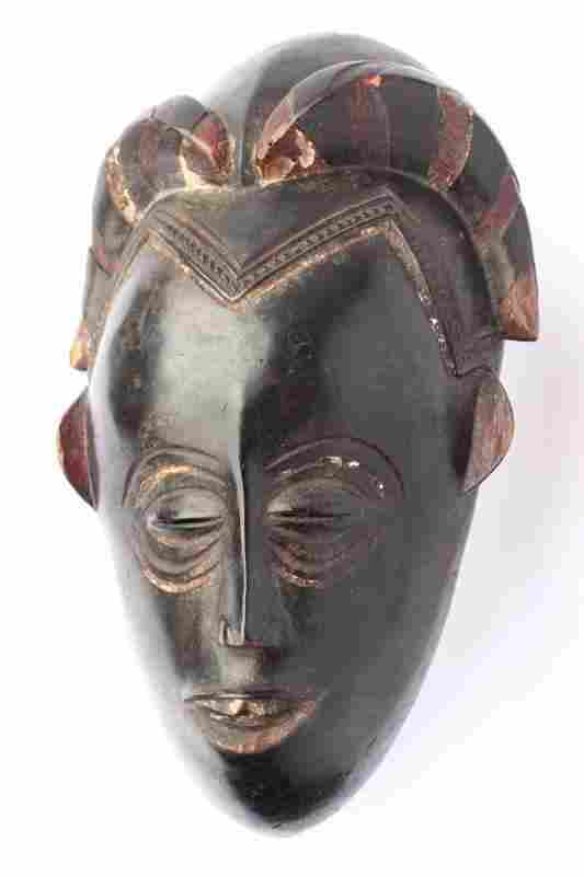 Old Guro Mask Of A Woman's Face with an Elaborate