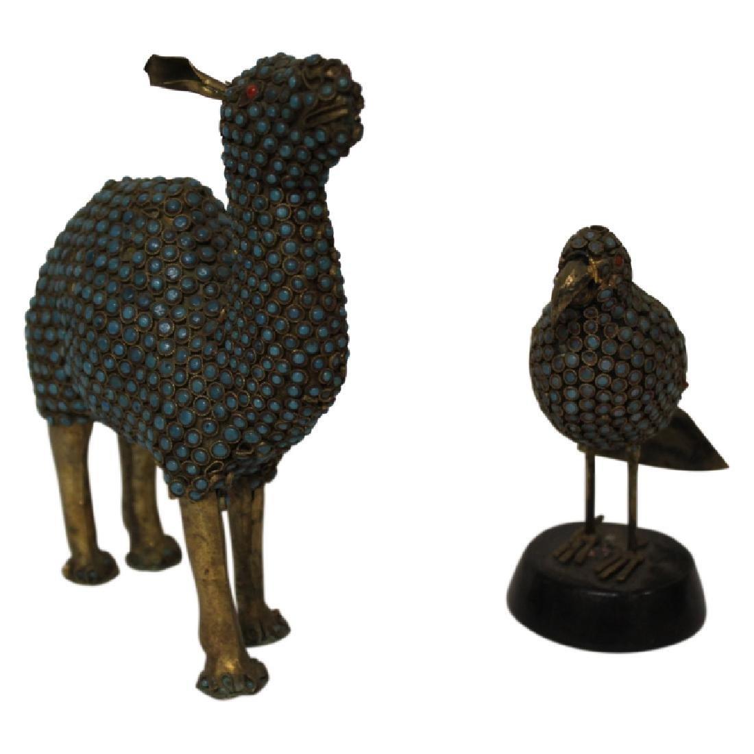 Pair of Stone Encrusted Wildlife Figures
