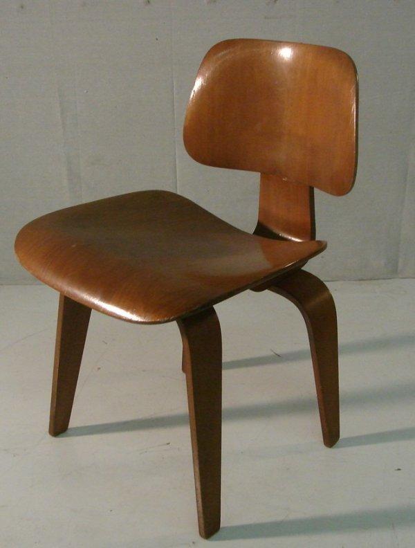 12: Eames Walnut lounge chair