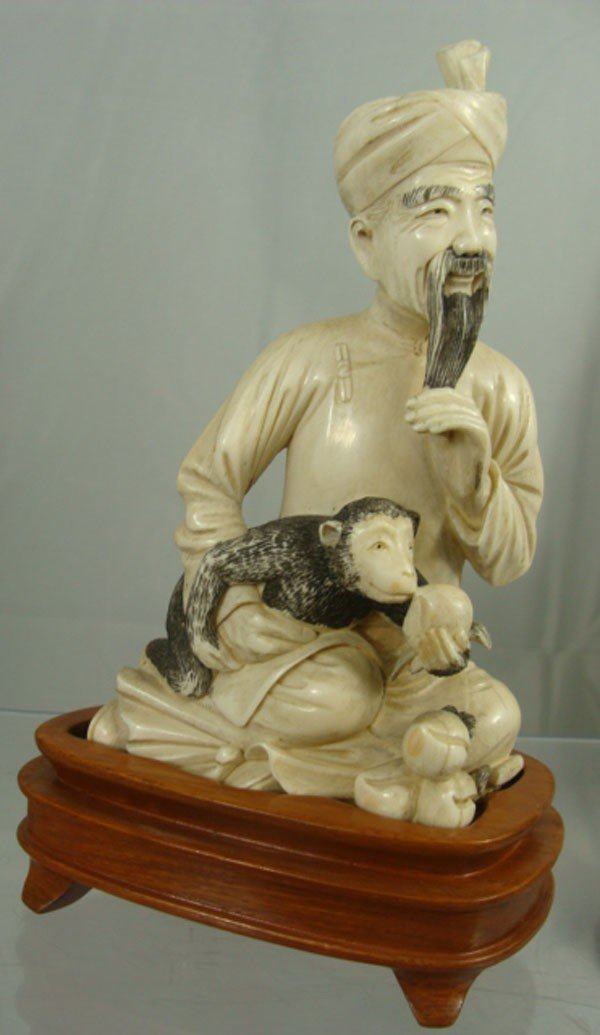 1: Chinese Carved Ivory Man and Monkey Figure