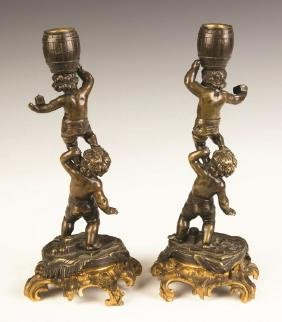 French Bronze and Gilt Bronze Putti Candlesticks