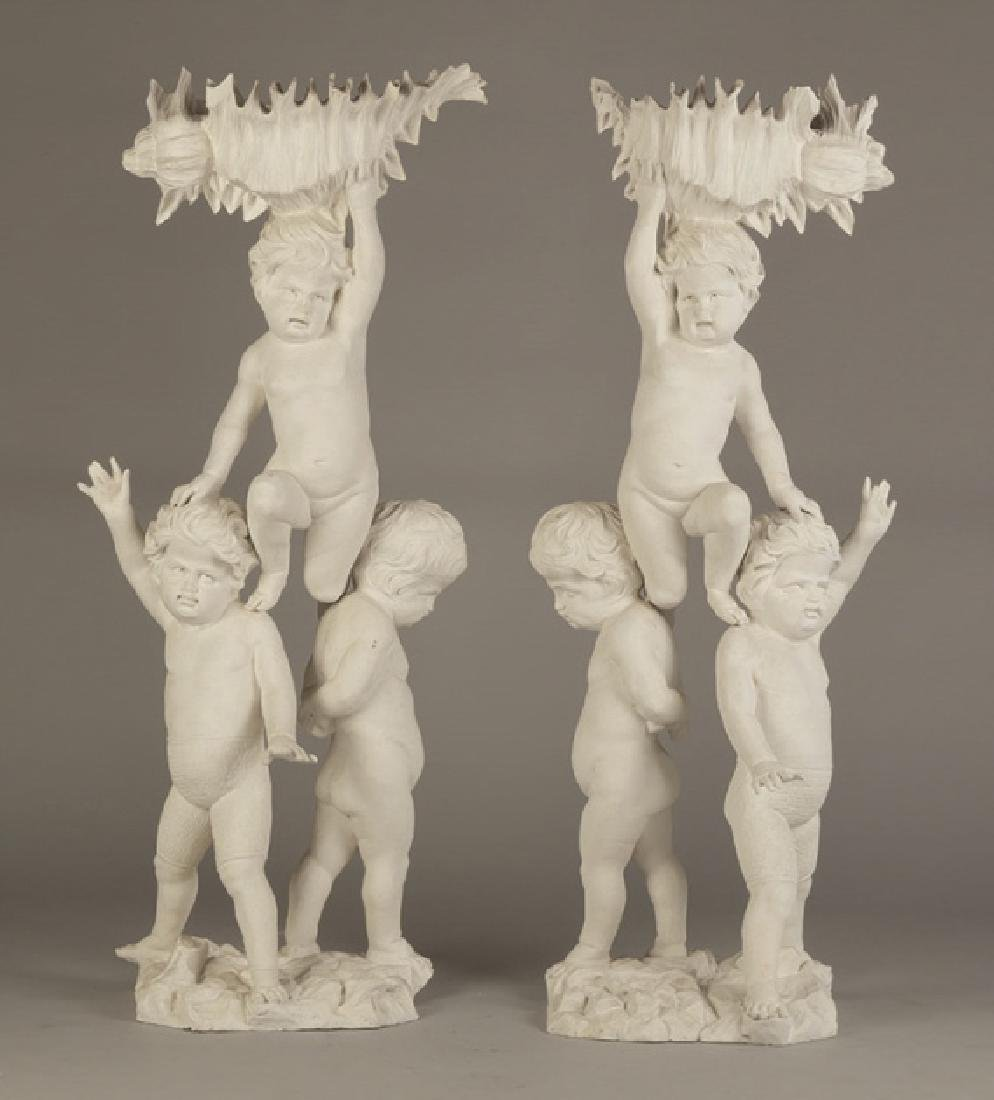 Pair of Carved Putti Pedestals