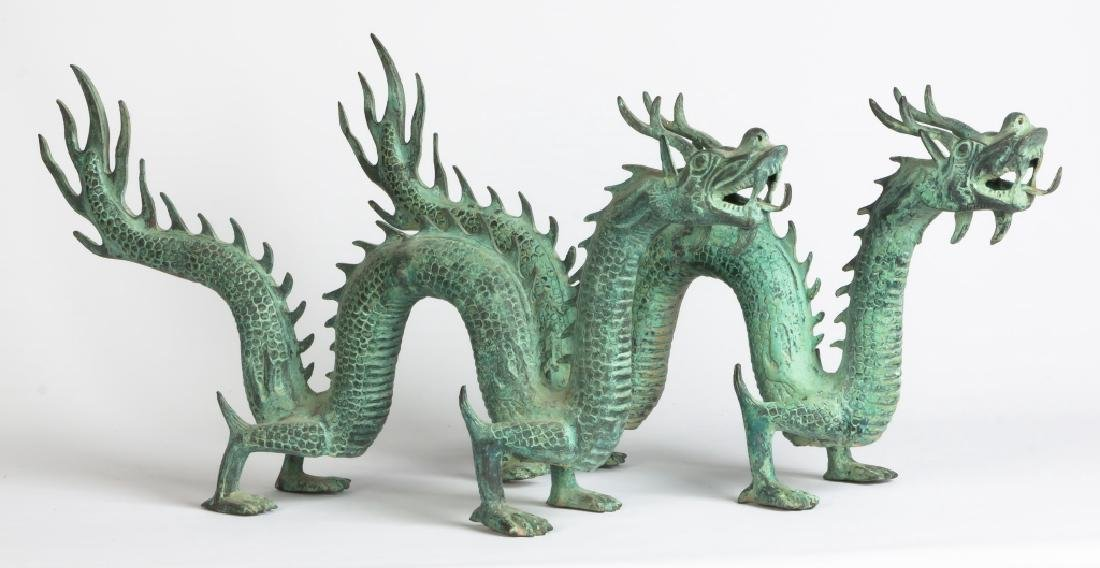 Pair of Asian Patinaed Metal Dragons