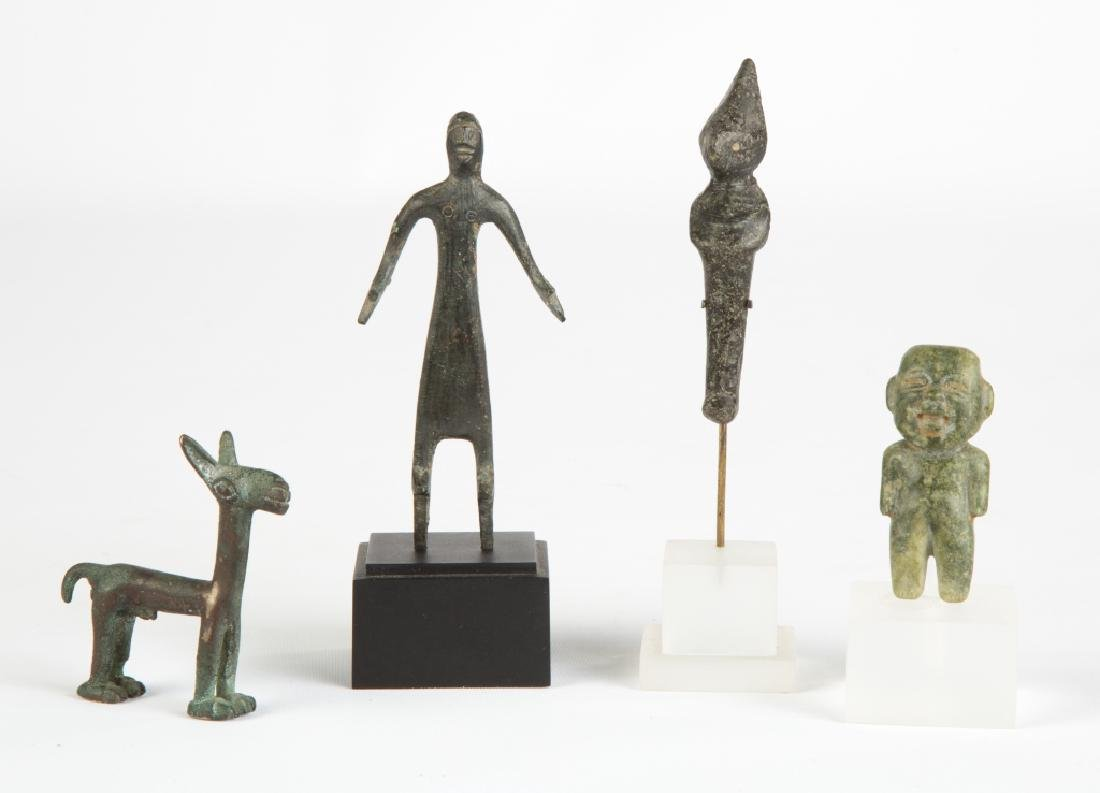 Four Early Metal and Stone Figures