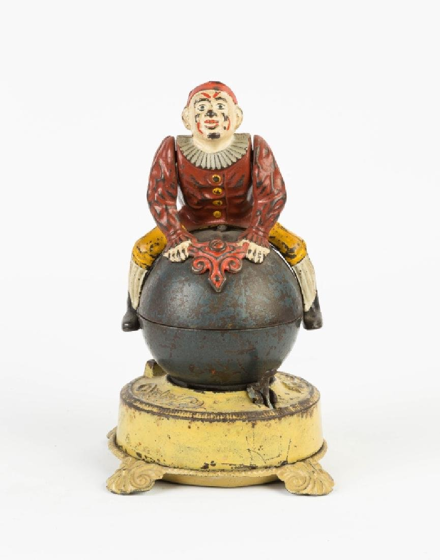 Clown on Globe Cast Iron Mechanical Bank