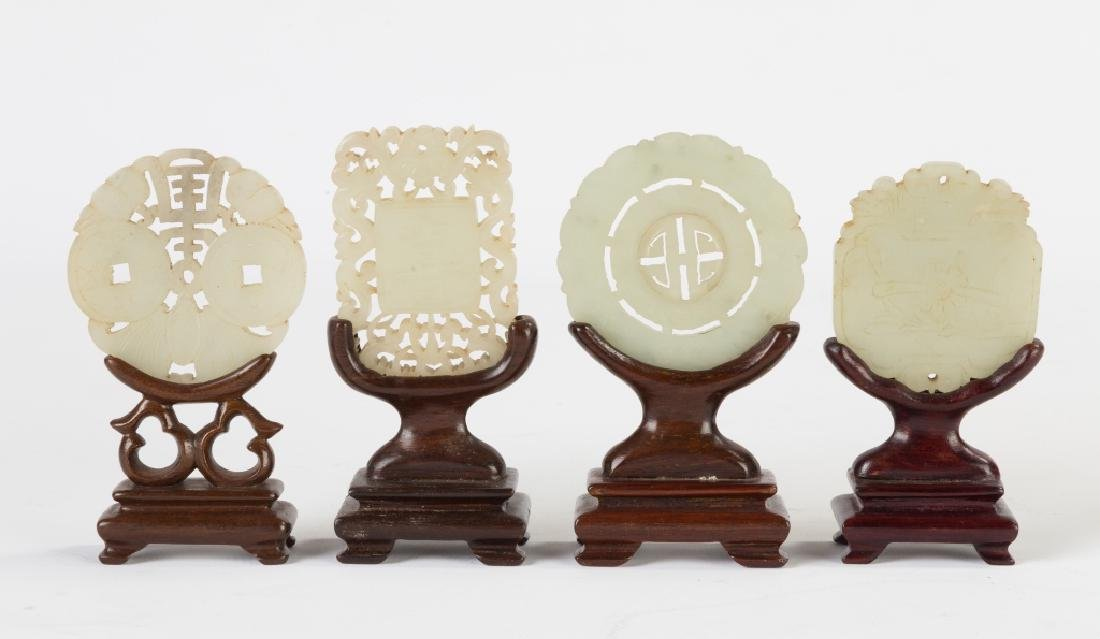 Four Chinese Carved Jade Pendants