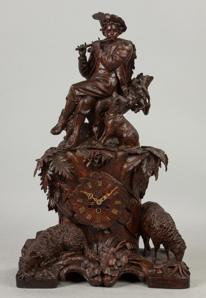 Carved Black Forest Clock with Figure Playing Flute,