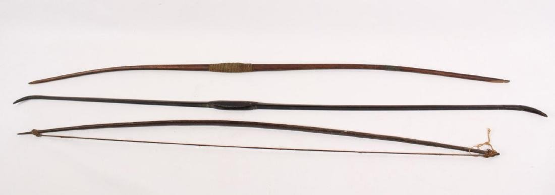 3 LARGE AFRICAN CARVED WOODEN LONG BOWS