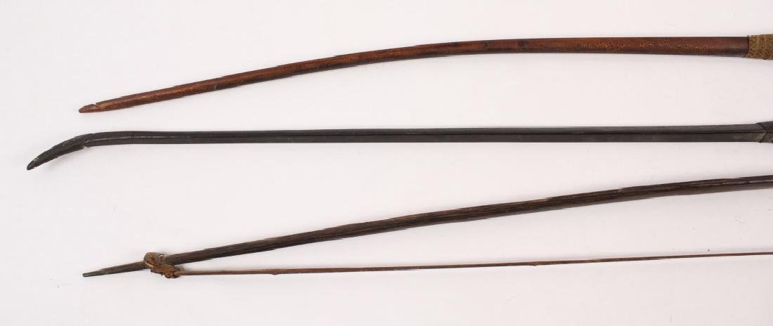 3 LARGE AFRICAN CARVED WOODEN LONG BOWS - 3