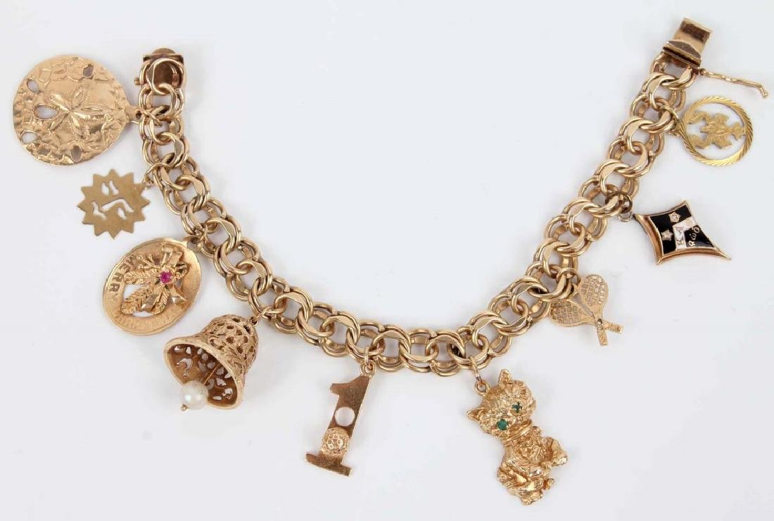 14K YELLOW GOLD CHARM BRACELET WITH NINE CHARMS