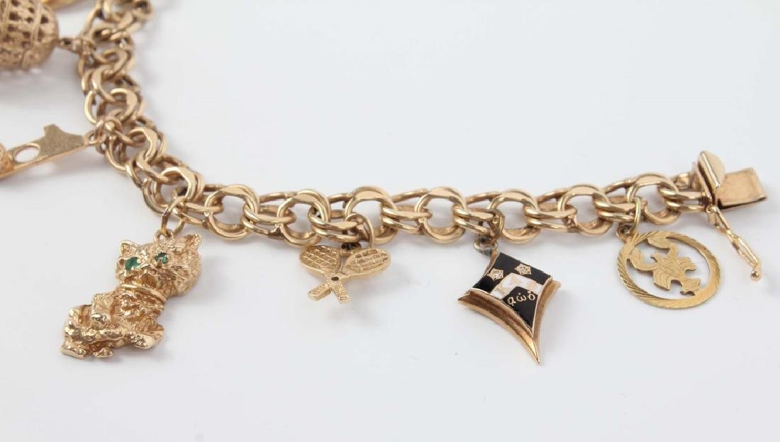 14K YELLOW GOLD CHARM BRACELET WITH NINE CHARMS - 3