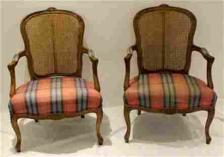 MATCHED PAIR OF MAHOGANY CANE BACK ARM CHAIRS