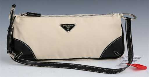 ef221929a6d9c3 PRADA CREAM COLORED LEATHER SEMITRACOLLA HAND BAG. placeholder