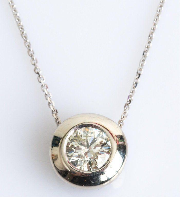 1 CARAT PLUS DIAMOND PENDANT SET IN PLATINUM