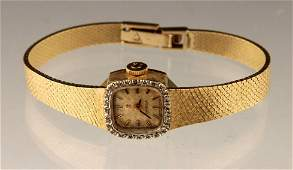 14K GOLD LADIES OMEGA DIAMOND BEZEL WRIST WATCH