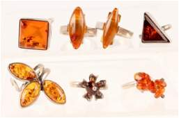 7 STERLING SILVER  AMBER RINGS