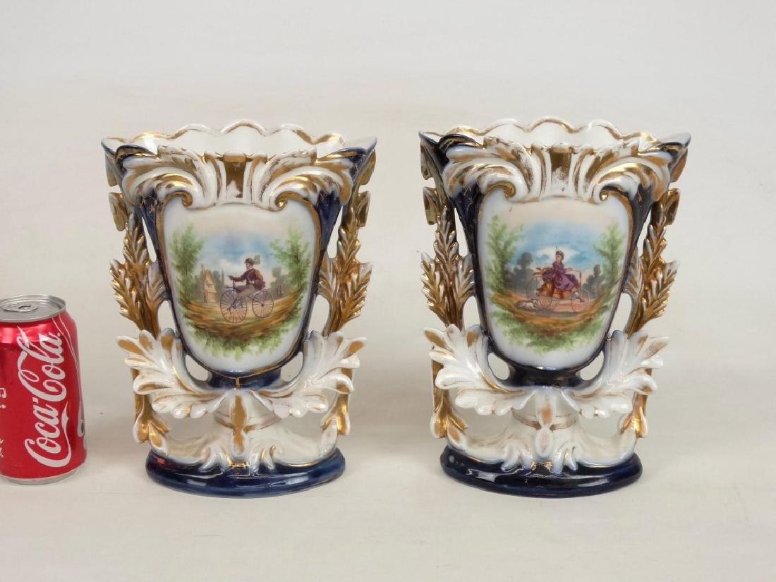 Pair 19th c. Porcelain Garnitures With Boneshakers