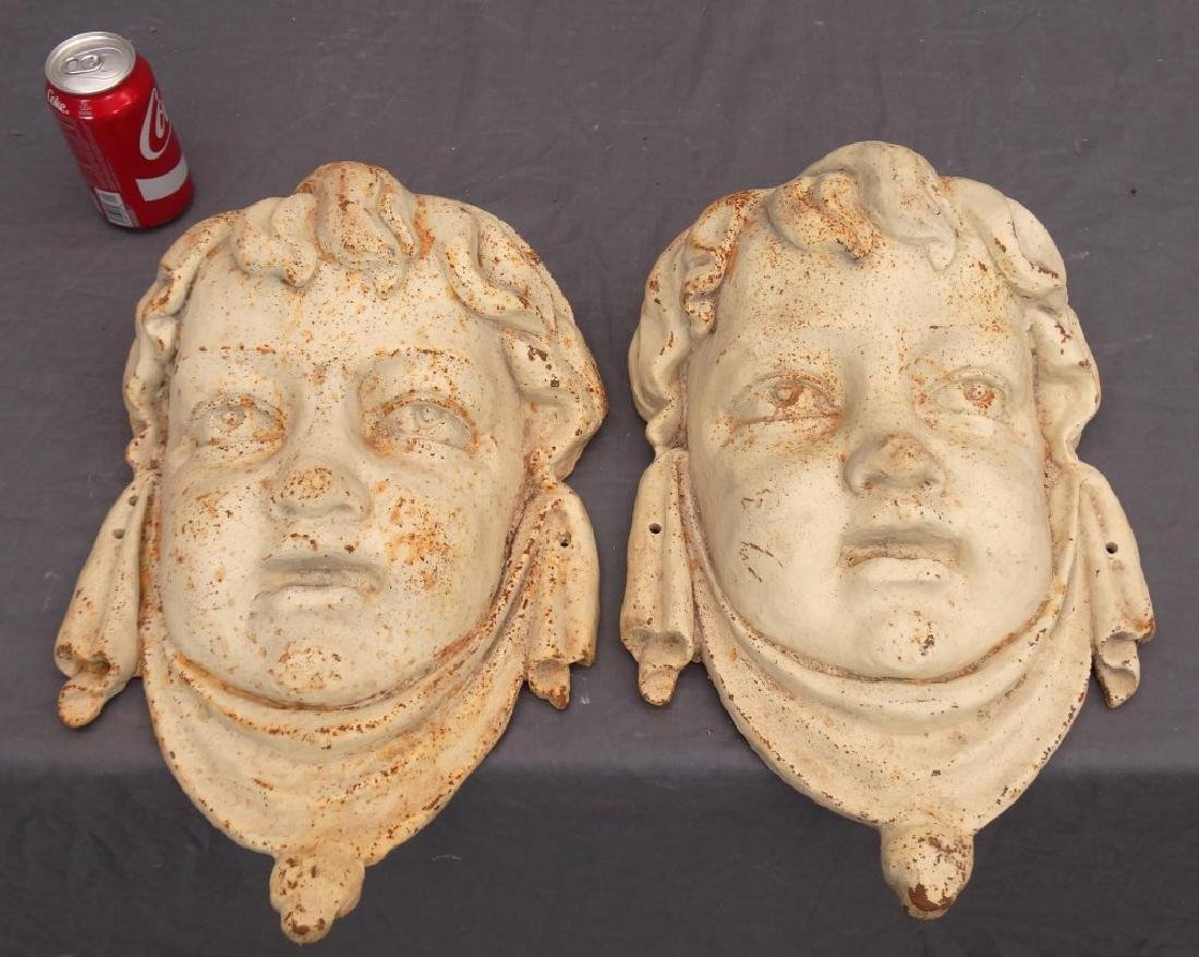 Pair Cast Iron Masks