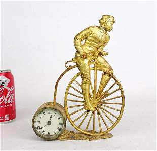 Early Figural High Wheel Clock