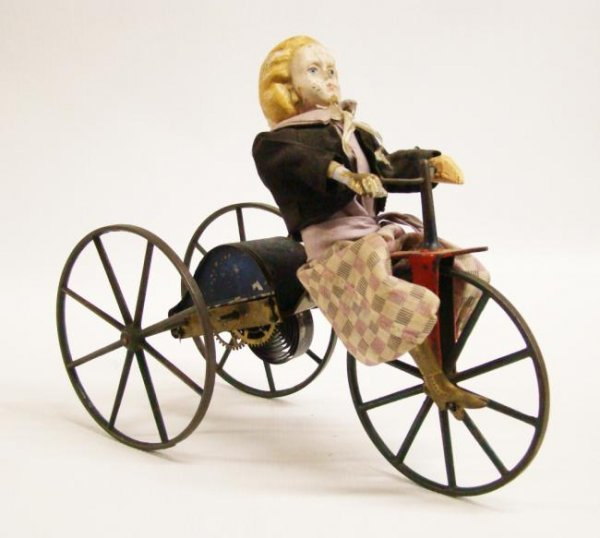 "19th c. ""Girl On Tricycle"" Clockwork Toy"