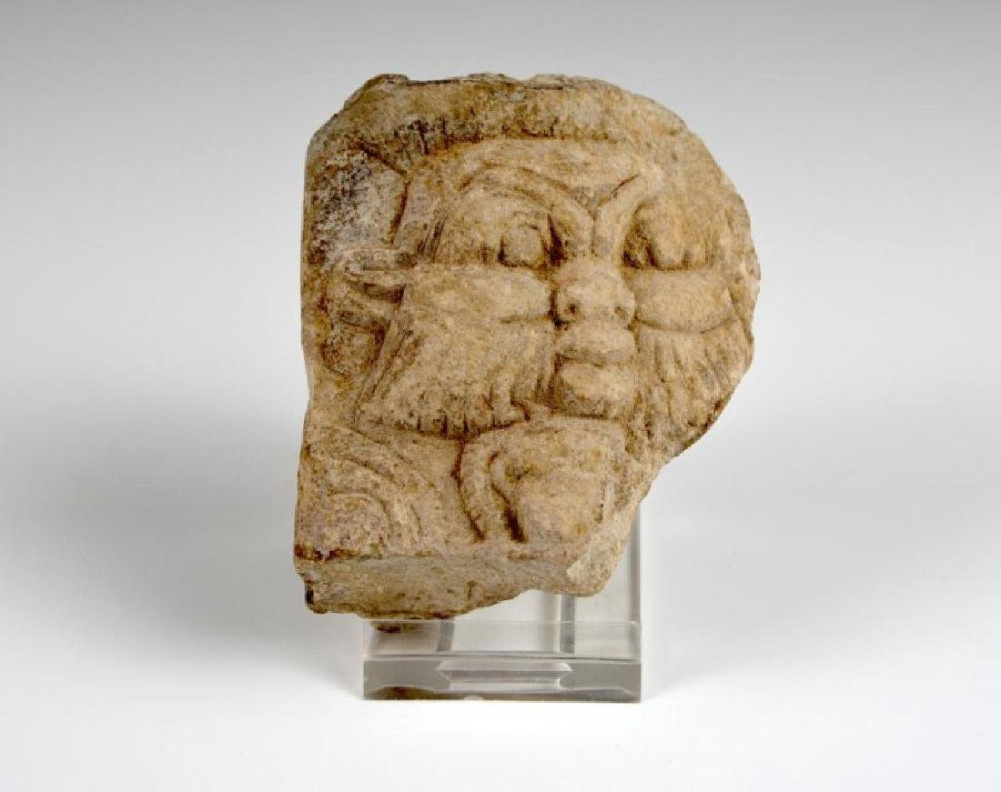 AN EGYPTIAN STONE CARVING OF A GOD