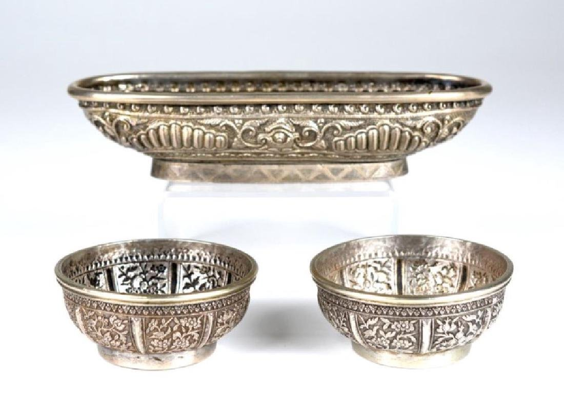 THREE SOUTH EAST ASIAN SILVER BETEL NUT CONTAINERS