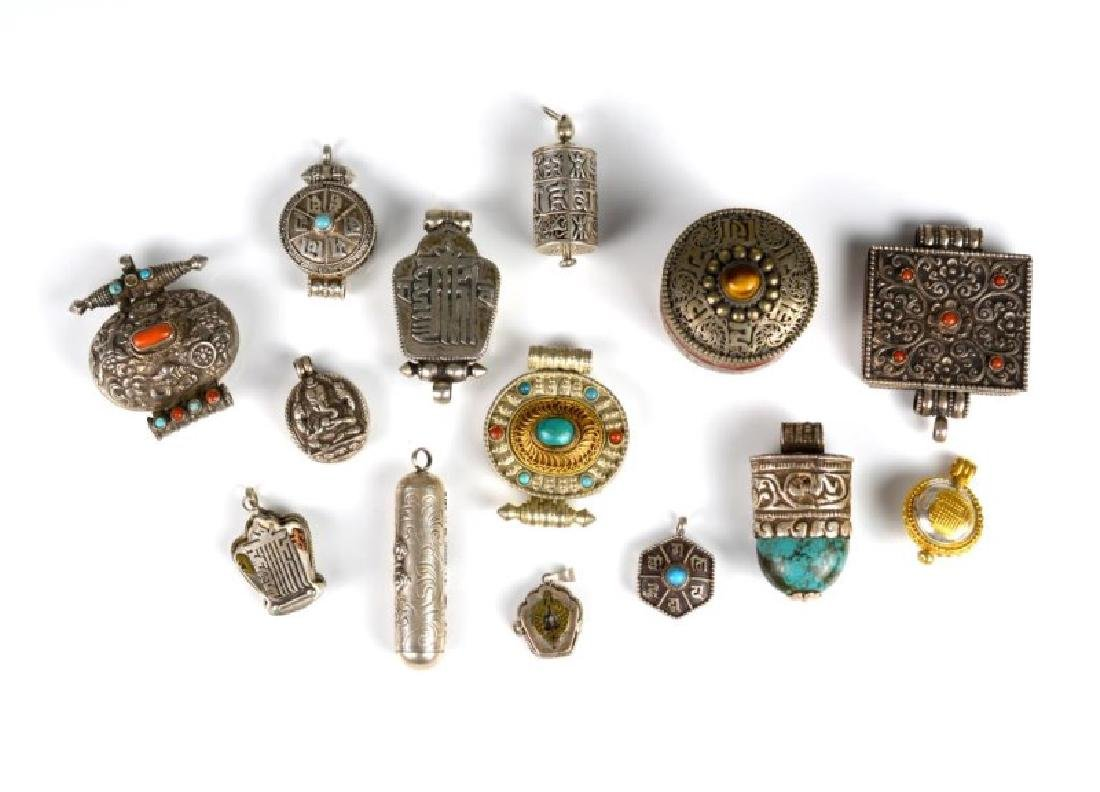 FOURTEEN TIBETAN GA'U PRAYER BOXES AND CHARMS