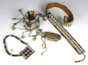FOUR SOUTHEAST ASIAN AND AFRICAN BEADED ITEMS