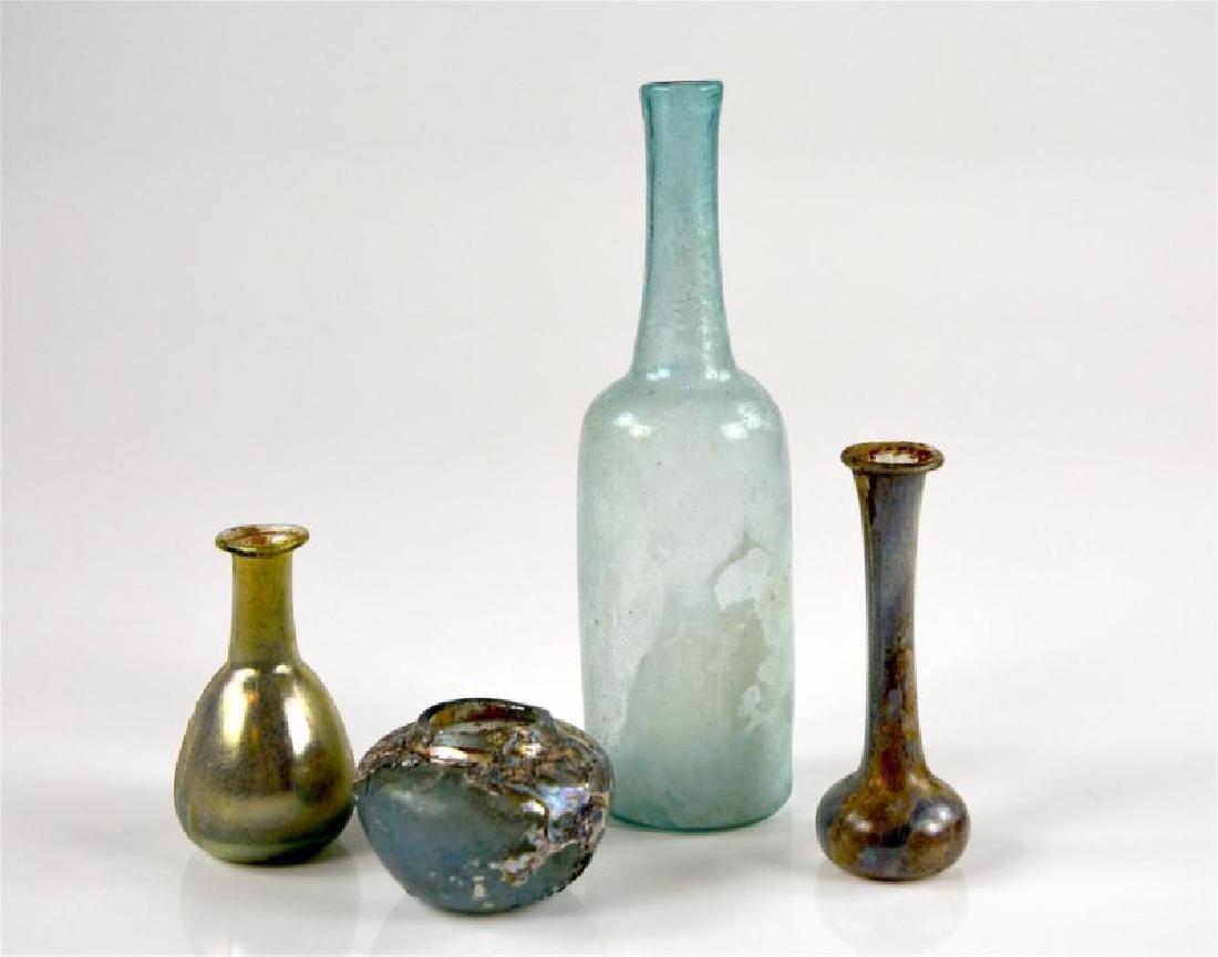 FOUR PIECES OF ROMAN GLASS