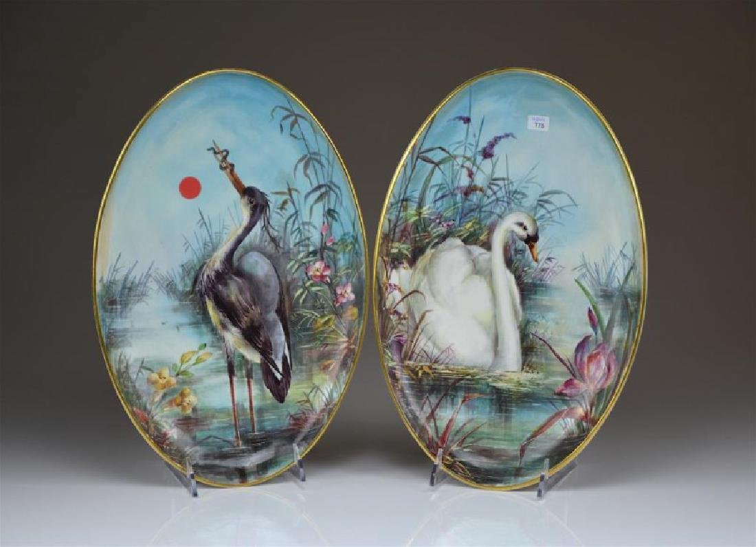 PAIR OF HAND PAINTED PORCELAIN PLAQUES