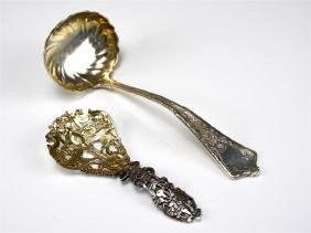 TWO AMERICAN SILVER SERVING SPOONS