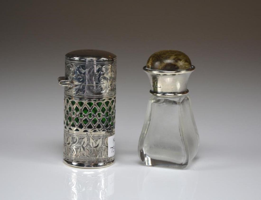 TWO ENGLISH SILVER MOUNTED SCENT BOTTLES