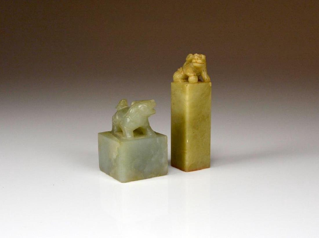 TWO CARVED JADE AND SOAPSTONE SEALS