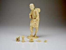 JAPANESE CARVED OKIMONO FIGURE OF A DRUM SELLER