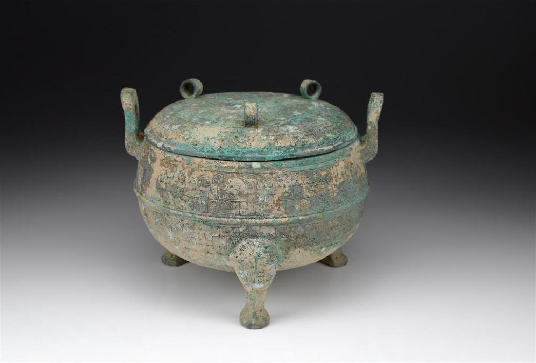 CHINESE BRONZE COVERED TRIPOD DING VESSEL