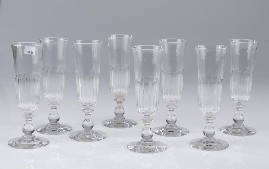 Eight Georgian cut glass champagne flutes