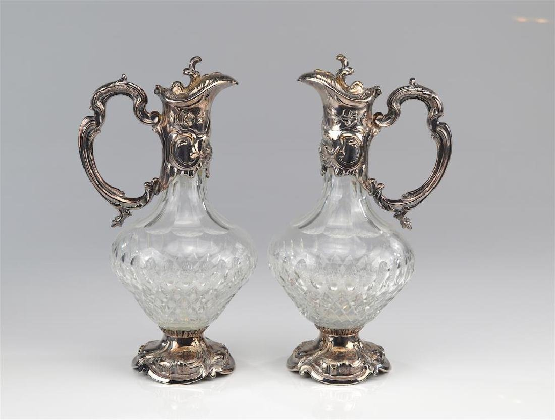 Pair of cut glass and silver plate claret jugs