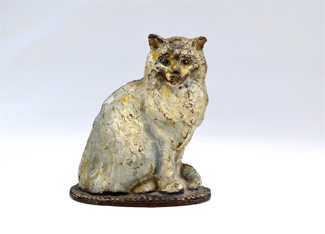 Antique painted cast iron seated cat doorstop