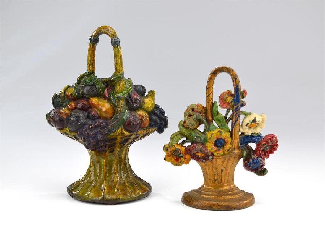 Two antique painted cast iron doorstops