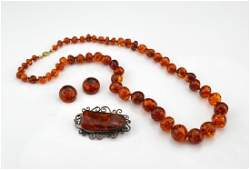 Amber beaded necklace, earrings, and brooch