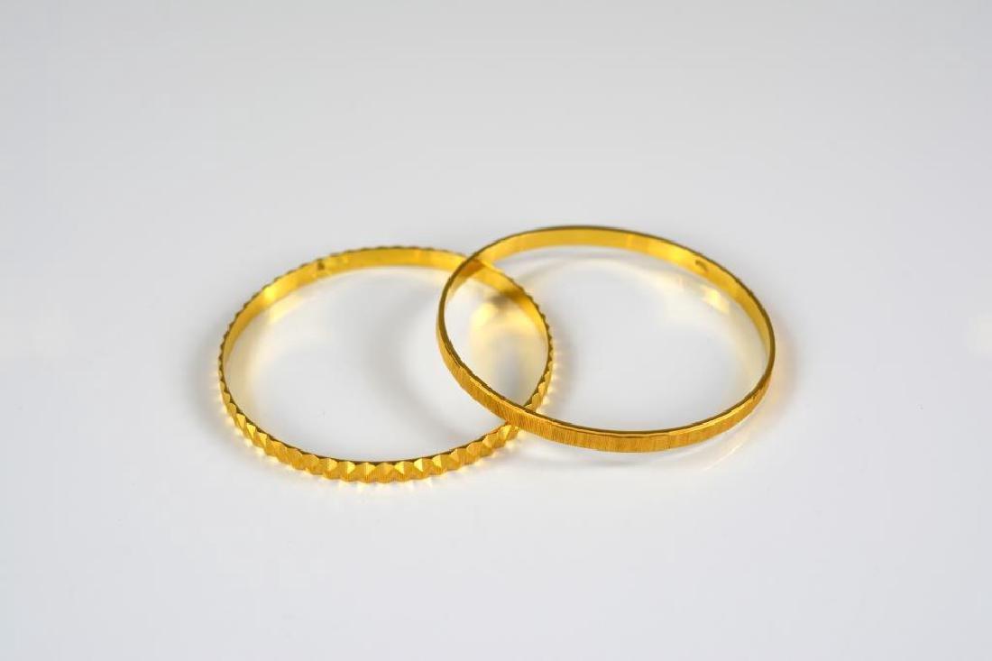 Two yellow gold Persian bangle bracelets
