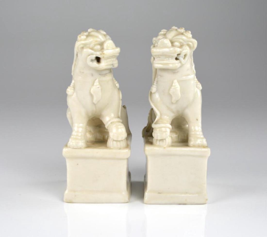 PAIR OF DEHUA PORCELAIN GUARDIAN LION FIGURES