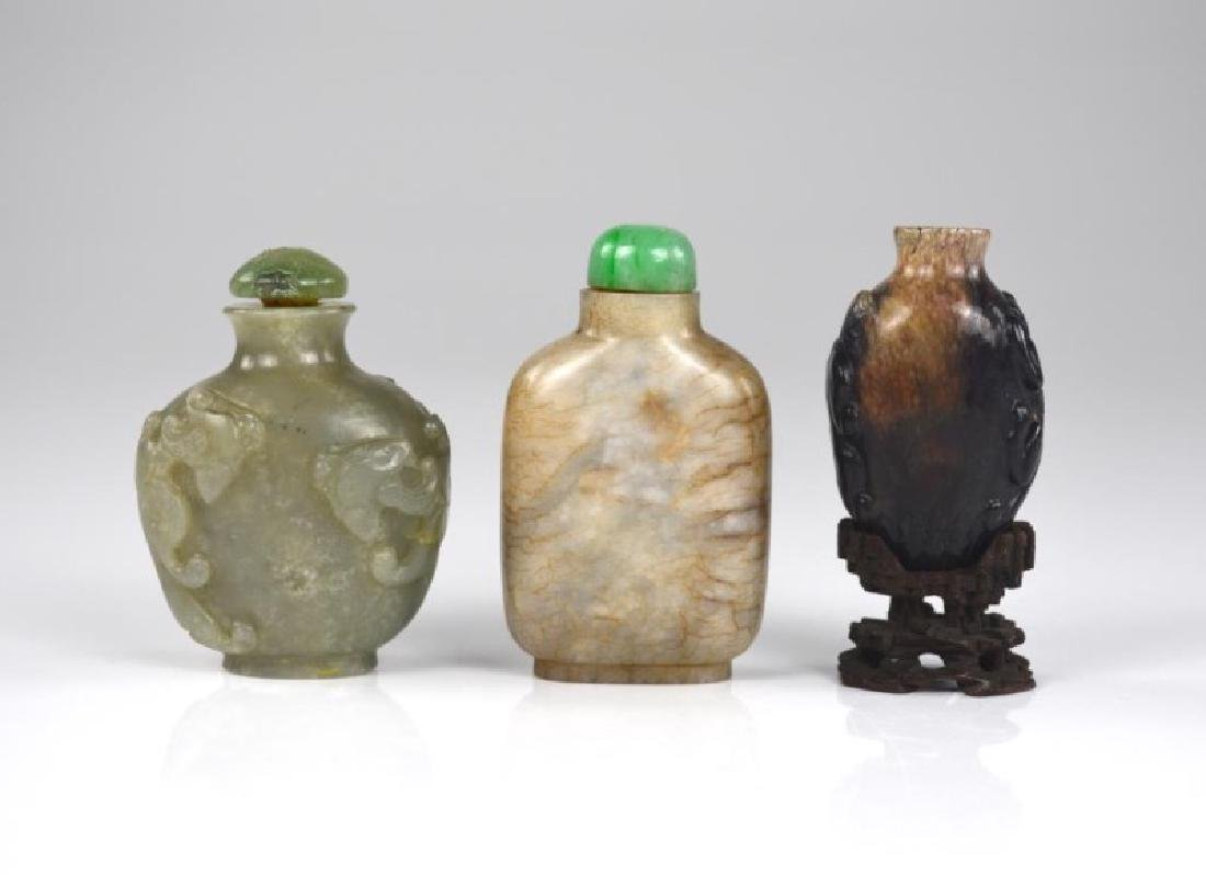 GROUP OF THREE CHINESE JADE CARVED SNUFF BOTTLES