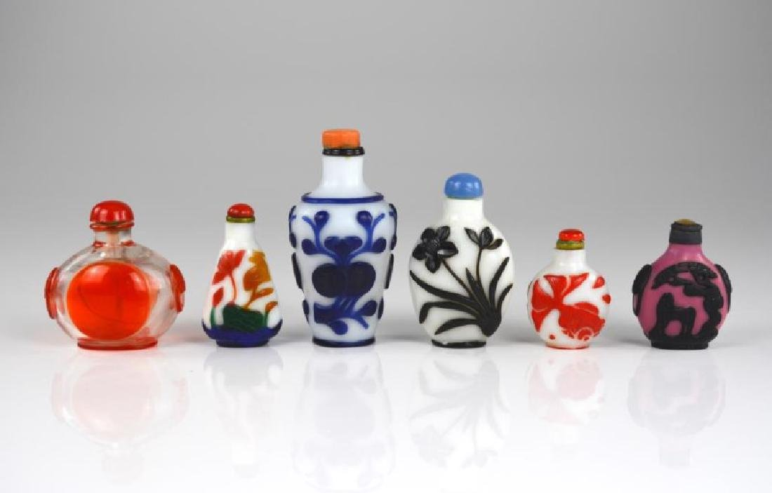 GROUP OF SIX CHINESE OVERLAY GLASS SNUFF BOTTLES